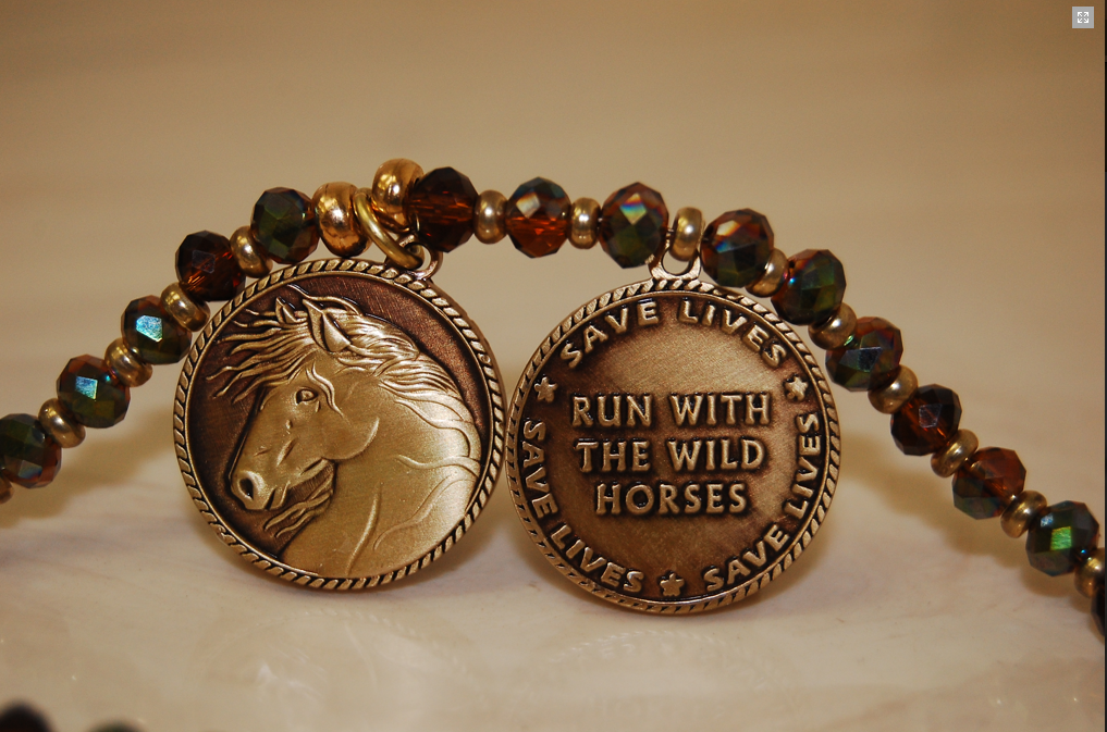 The necklaces are cast in bronze!  CLICK HERE if you'd llke to help the Navajo 12 - and if you'd like to put in your advance order for one of these Wild Horse Support bronze necklaces that are free with any $100+ donation!  ($75-$95 value!)