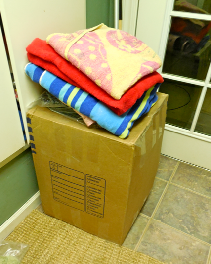 Here sits the box, for months, in my laundry room.  We started using it as a folding surface.