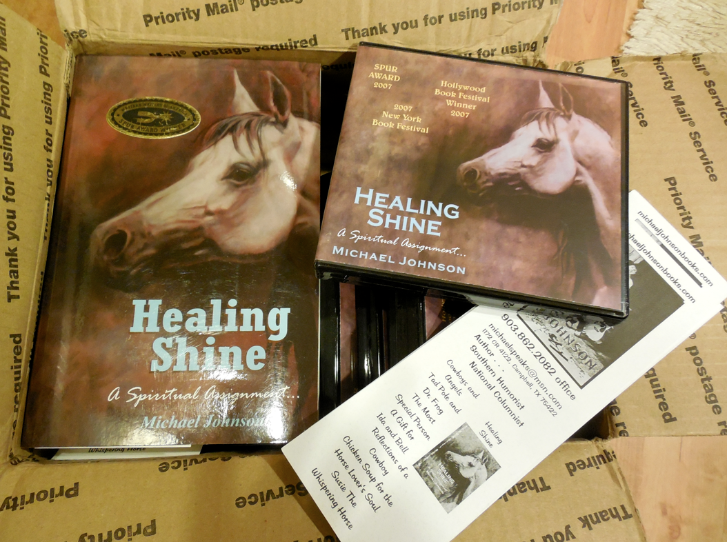 Here is the box that arrived from Michael Johnson of signed books and Audio CDs to sell for the benefit of the December Bucket Fund!