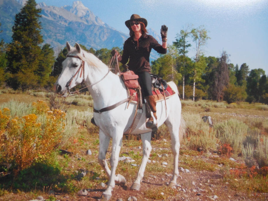 This is me and my partner for the week, Sky.  I had never ridden an Arab.  I loved  him.  We rode under the Tetons and everywhere we could in God's country.  Amazing.