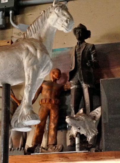 For example, high up on a shelf were these four items... the horse was the original model made to create a huge bronze for a woman in honor of her Shires.  The man is Jimmy Stewart.  The fox ended up hidden in a larger piece... every bit of stuff in his place had a story!