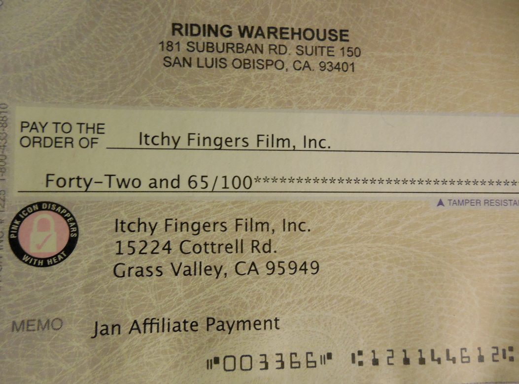Our check from Riding Warehouse.  Every time you purchase via the links in the sidebar or at the end of a post - a little money falls right into the Bucket Fund!  Thank you!