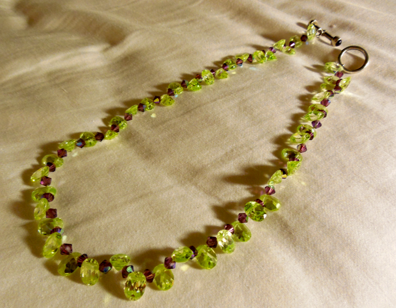 "Perfect Peridot drops and amethyst.  Gorgeous 15"" of Mother Nature's glitter."