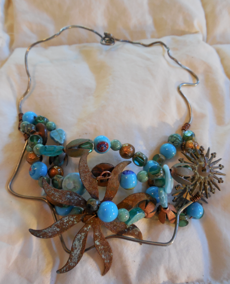 Beach Inspired choker with copper, beads, buttons, sea glass and sterling.  I bought this from a street artist in Sausalito...
