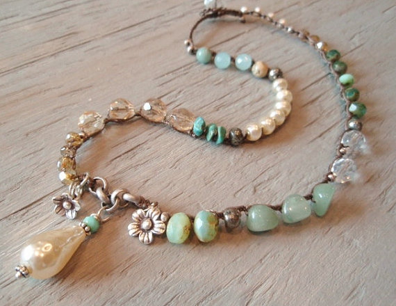 I love this mix-n-match of found objects and beads and pearls.  I wear mine almost every day with other beaded necklaces.
