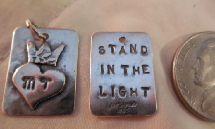"""Mama Tess' very own pendant to help with her medical bills!  The front has her initials and a crown (of course).  The back says, """"Stand in the Light""""!  Only $28!"""