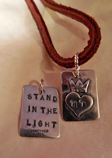MT's sterling silver pendant on leather lacing!