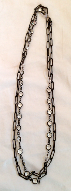 Gorgeous.  Hand made antique rectangular chain and round crystal faceted rings.
