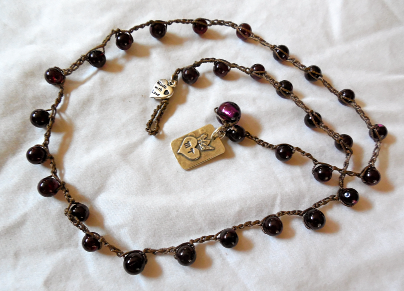"Garnet crocheted necklace with an MT ""Stand in the light"" sterling pendant and sterling heart added.  20""."