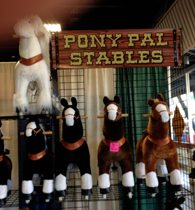 This was part of the booth.  You can see the small and medium sized horses.  Note the feet... casters, I think.