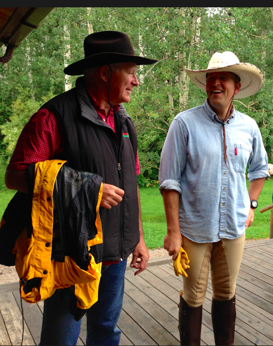We didn't get too wet... Here is Hubby with Adam, our friend, after the morning ride.  We were on the deck, waiting for breakfast.