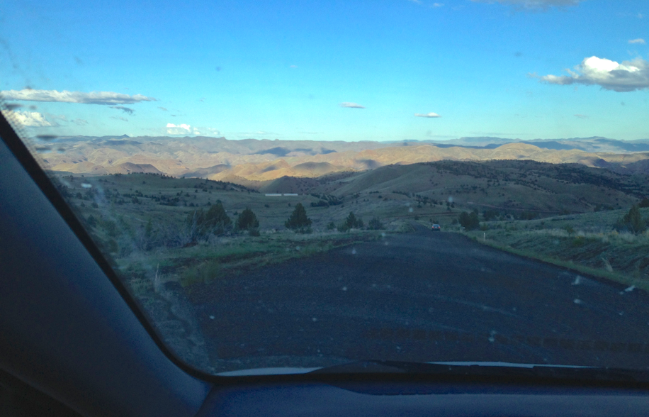 The view of the epic 12 mile, private, gravel road - down into the unknown valley.