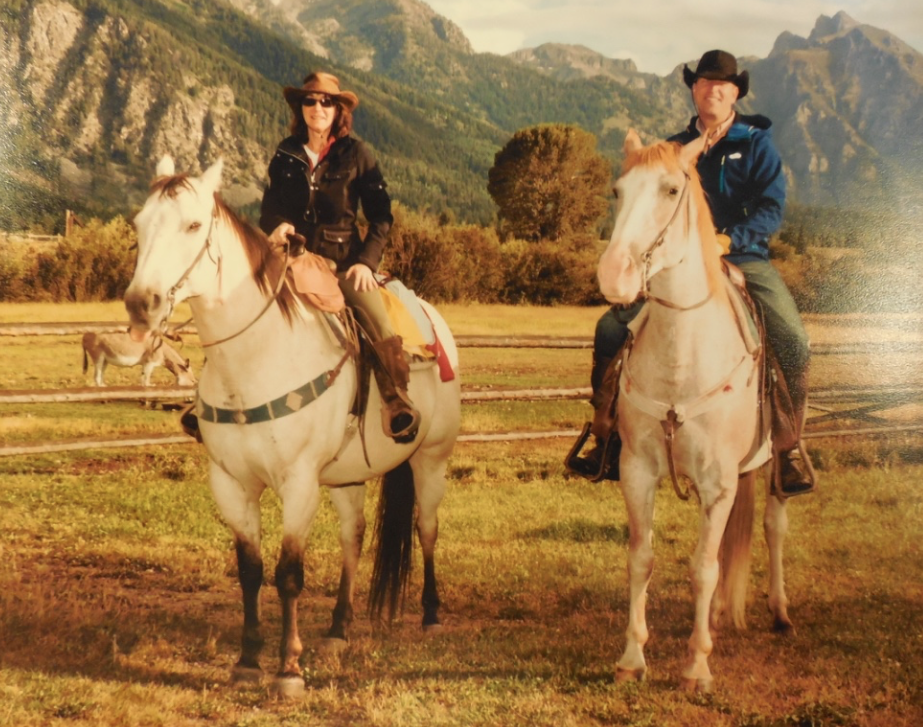 This is a photo of me and Hubby in Wyoming.  I'm on Paco, who I only rode for a short time because he stepped on a rock and became sore (he has his tongue out in this photo) and Hubby is on his new girlfriend, Rose.  Hubby adored her!~  She was half Walker and half Quarterhorse.