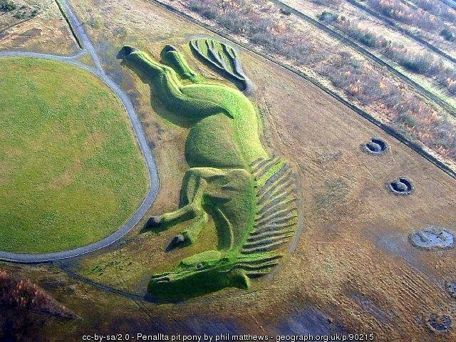 The UK's largest earth sculpture was built with 60,000 tons of coal shale, stone, and soil on the site of a former coal mine in Wales. 'Sultan the Pit Pony' was created by artist Mick Petts