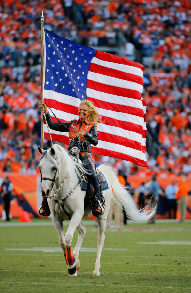 DENVER, CO - SEPTEMBER 07: Thunder the Denver Broncos mascot is ridden down the field by Ann Judge-Wegener after the Denver Broncos scores against the Indianapolis Colts at Sports Authority Field at Mile High on September 7, 2014 in Denver, Colorado. (Photo by Doug Pensinger/Getty Images)