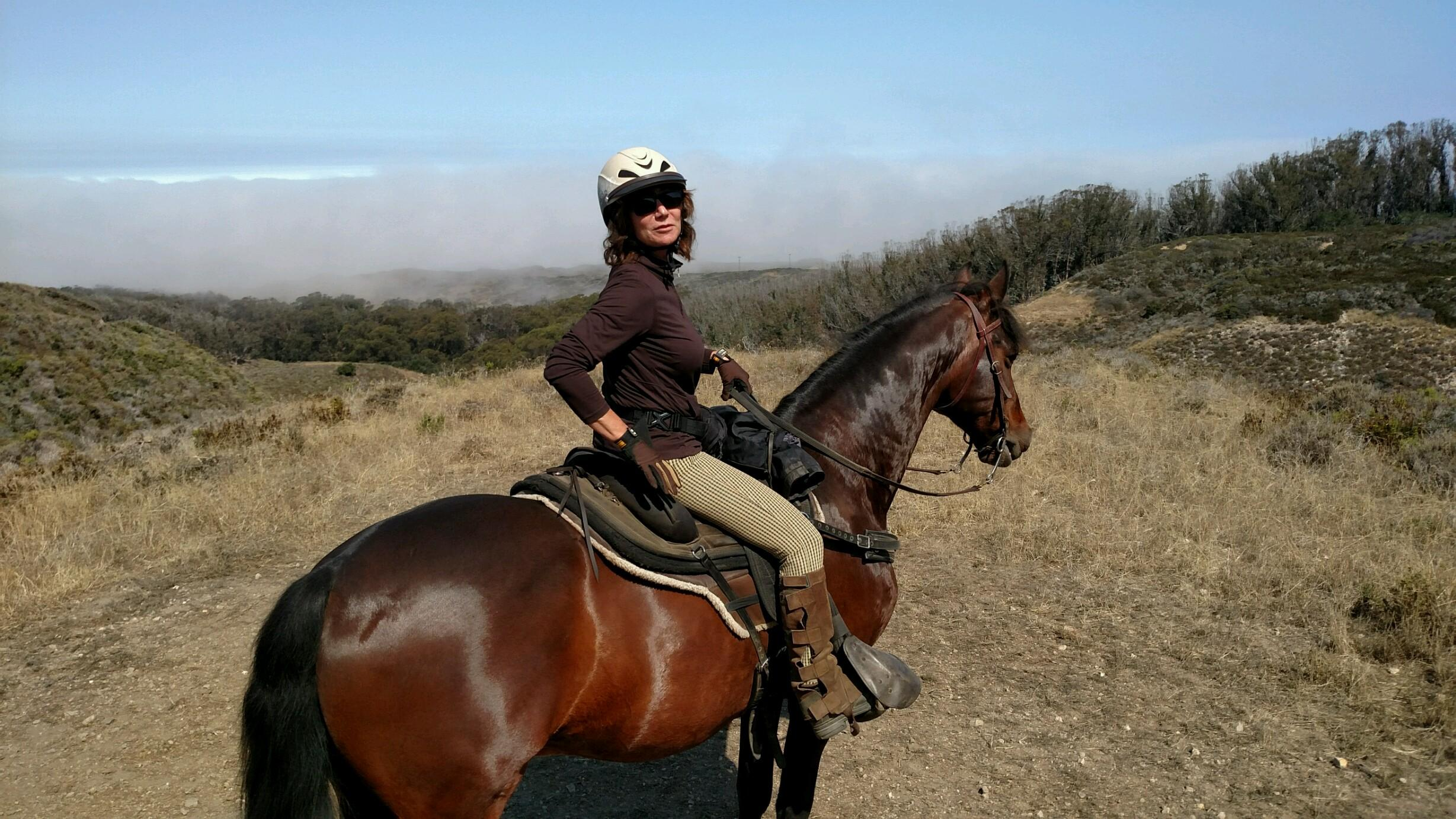 Me, at the beginning of the ride. Isn't Rambo handsome? The ocean is by that fog bank.