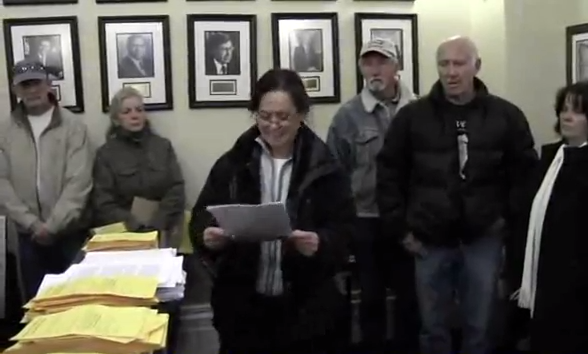 This is a photo from the video (click image to watch) where the AWHPC advocates went to the Nevada Governor's office and delivered 2000 letters from around the world.