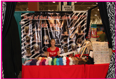 This is a photo from her website of the EZ Bun booth.  Small yet effective.