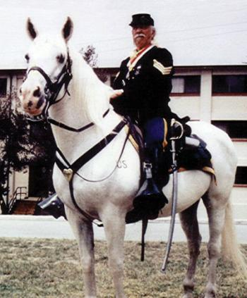 SGT. MACDONALD ON THE ORIGINAL COMANCHE - A BLM MARE - WHO IS BURIED AT FORT ORD.