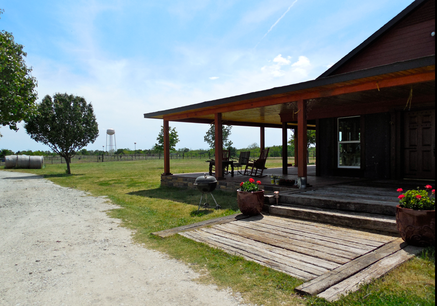 The total wrap around porch was lovely and peaceful!  The main house was not finished - but the barn was!